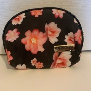 Small black make up bag with pink flowers